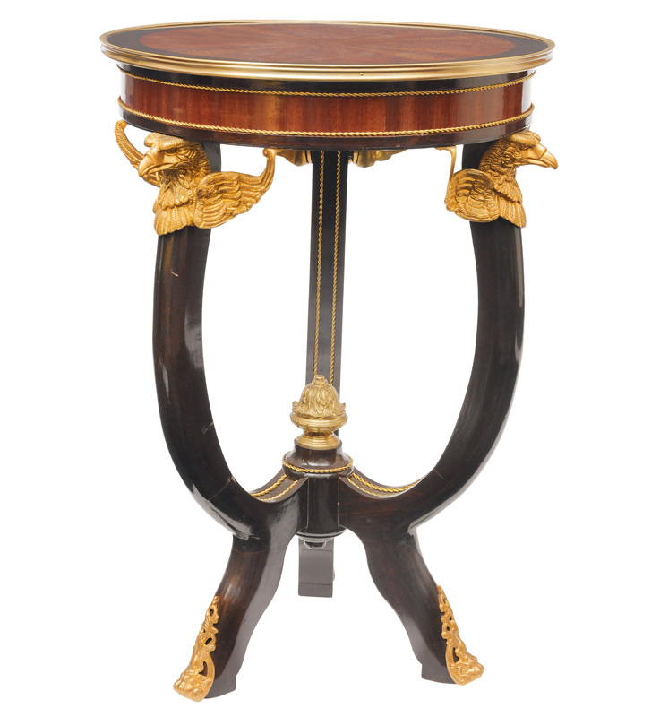 A round side table in the style of Empire