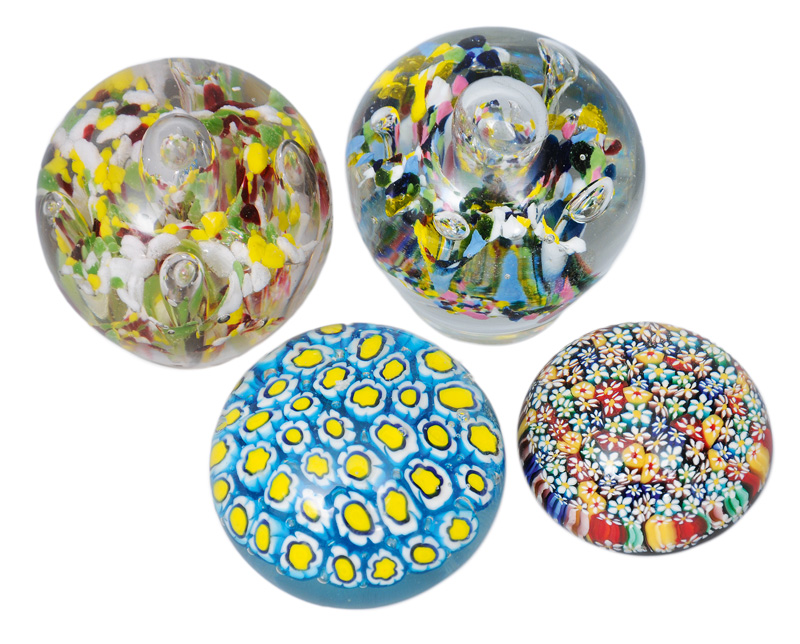 A set of four paperweights