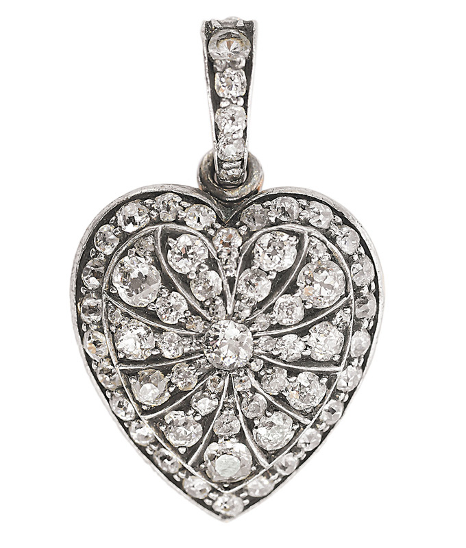 A diamond pendant in the shape of a heart