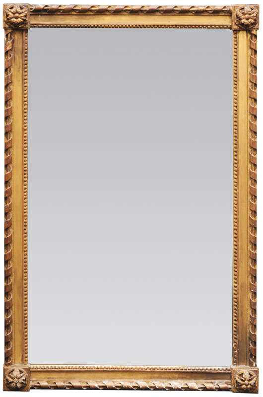 A mirror with Louis-Seize ornaments