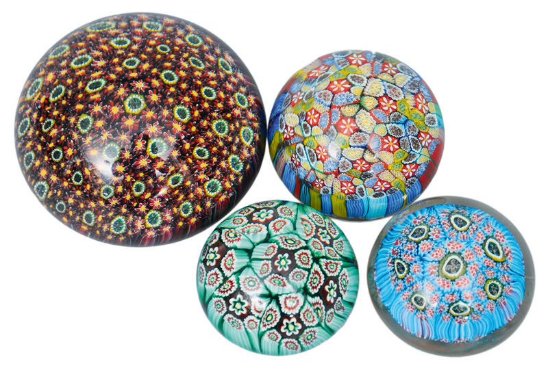 A set of four millefiori paperweights of Murano Design