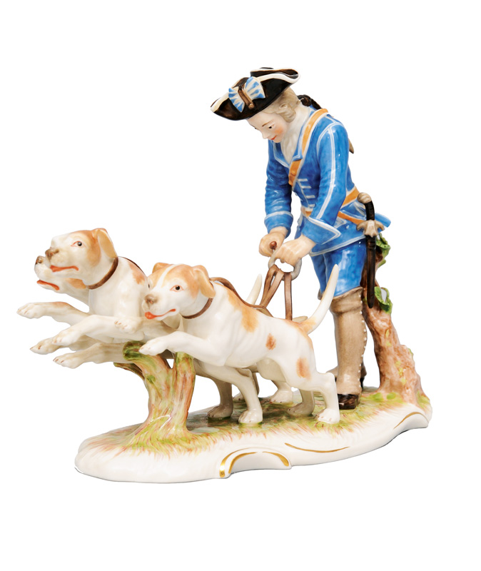 "A figurine ""Piqueur with 3 hunting dogs"""