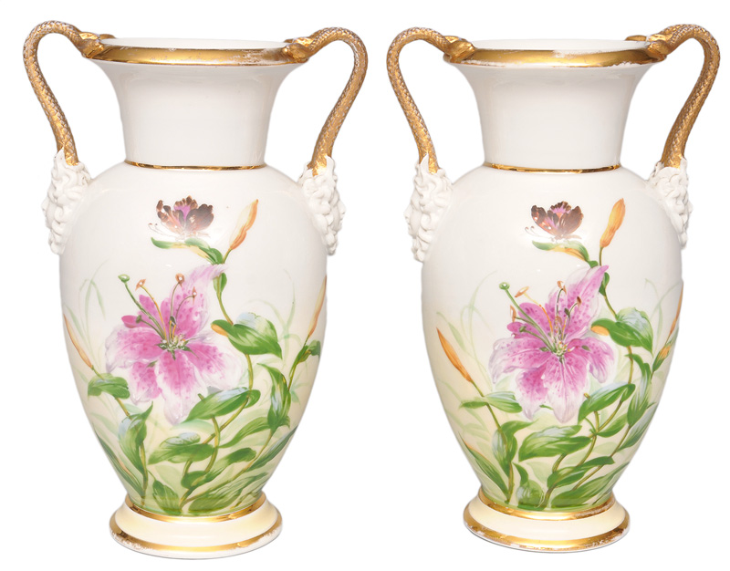 A pair of vases with snake handles and lillies