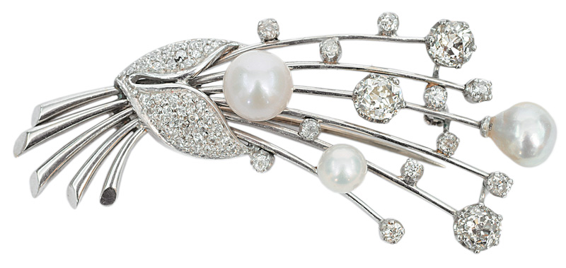 A diamond brooch with pearls