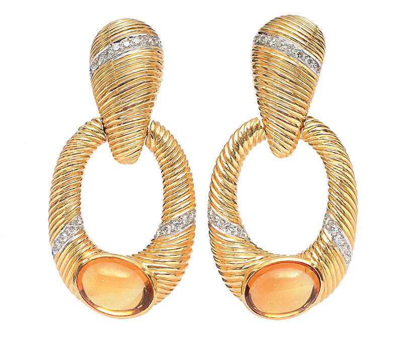 A pair of long golden earrings with citrines and diamonds
