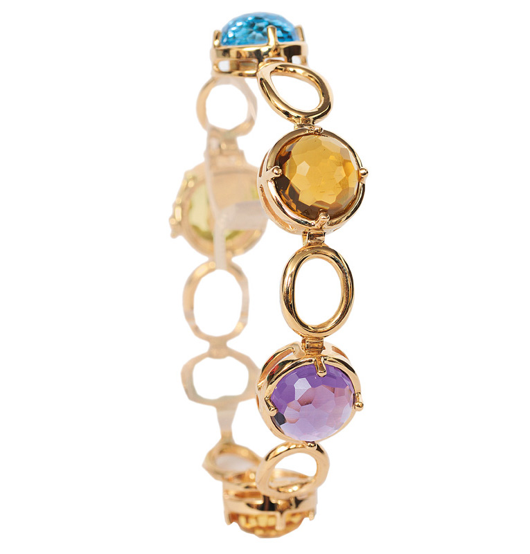 A golden bracelet with coloured stones