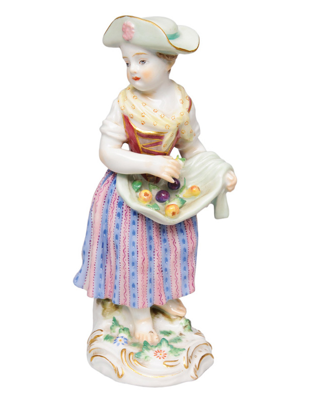 "A figurine ""Gardener""s child with fruits"""