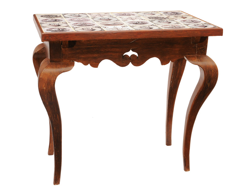 A Baroque table with ceramic tiles