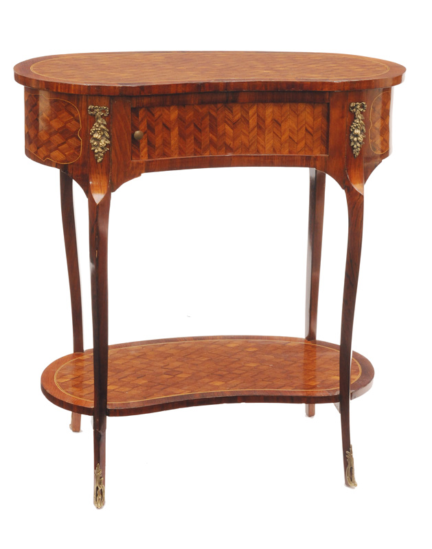 A Napoleon III table with rhombical marquetry