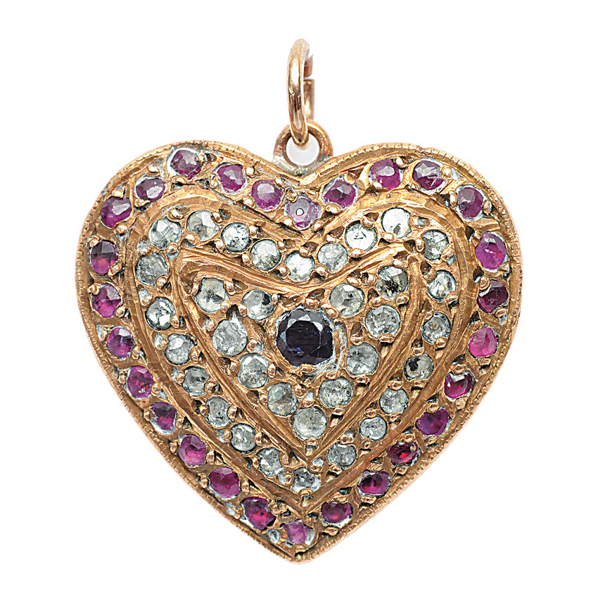 A diamond ruby pendant in the shape of a heart