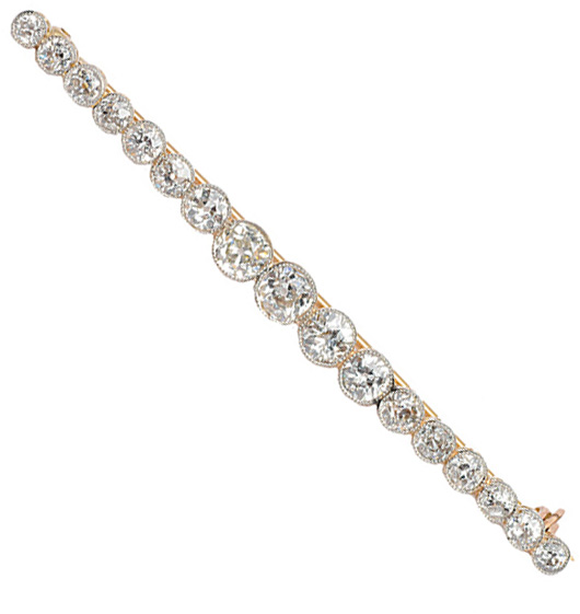 A needle brooch with diamonds