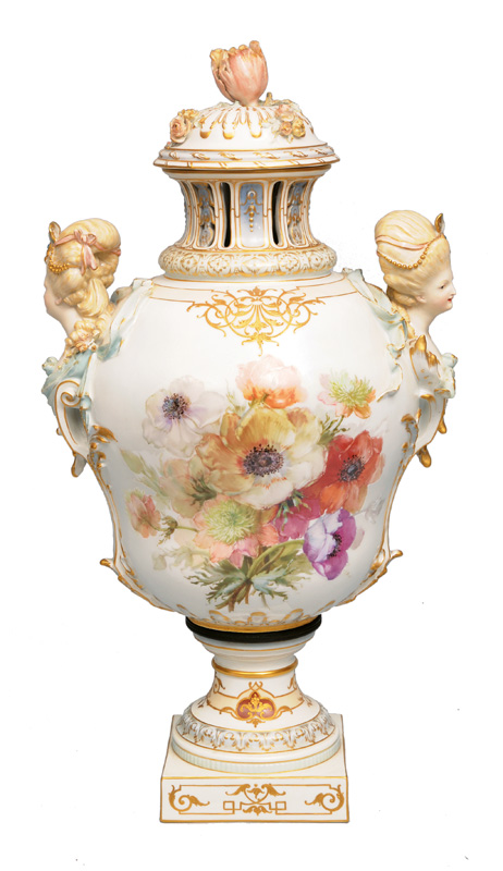 A tall potpourri vase with female heads