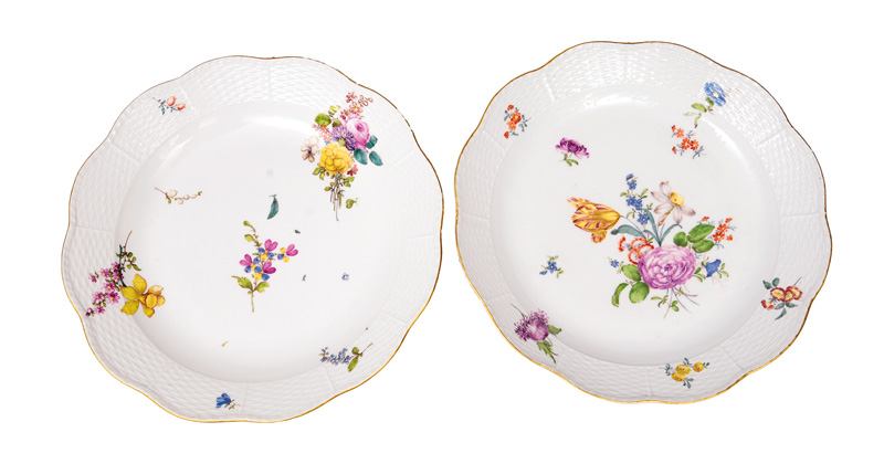 A pair of large circular plates with flower painting