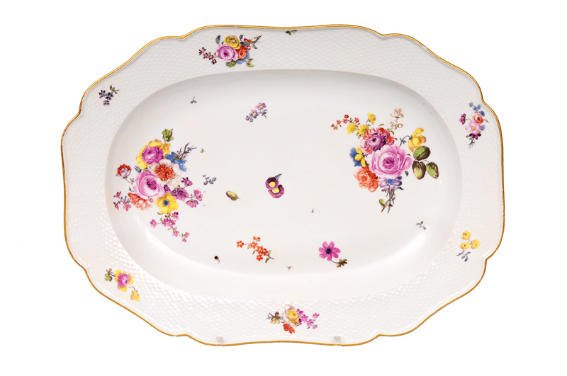 A large plate with flower painting
