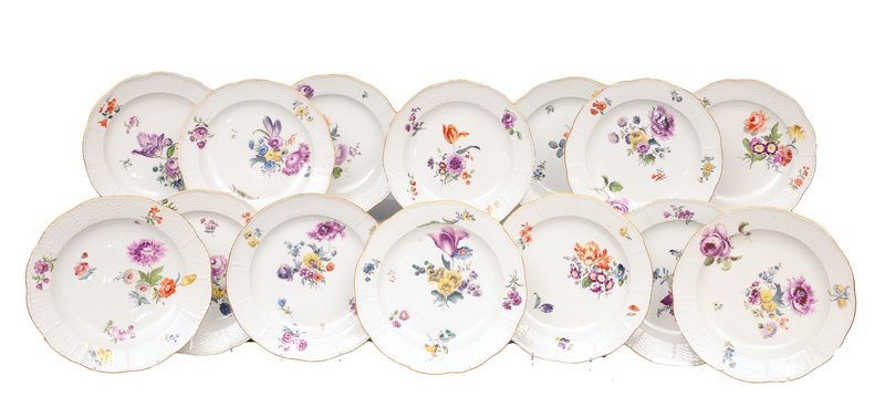 A set of 14 dinner plates with flower painting