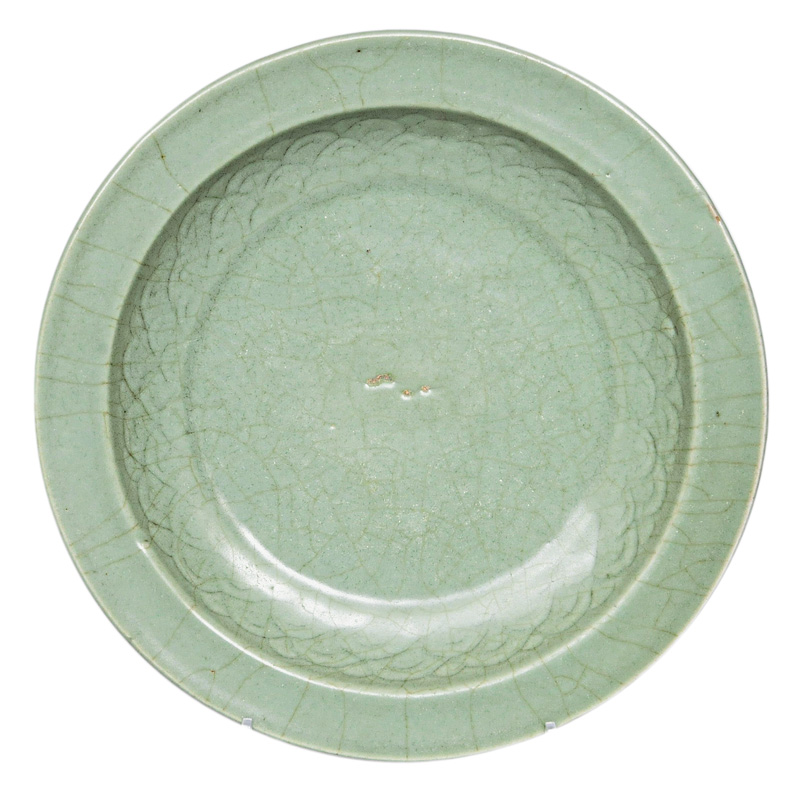 A celadon plate with wave decoration