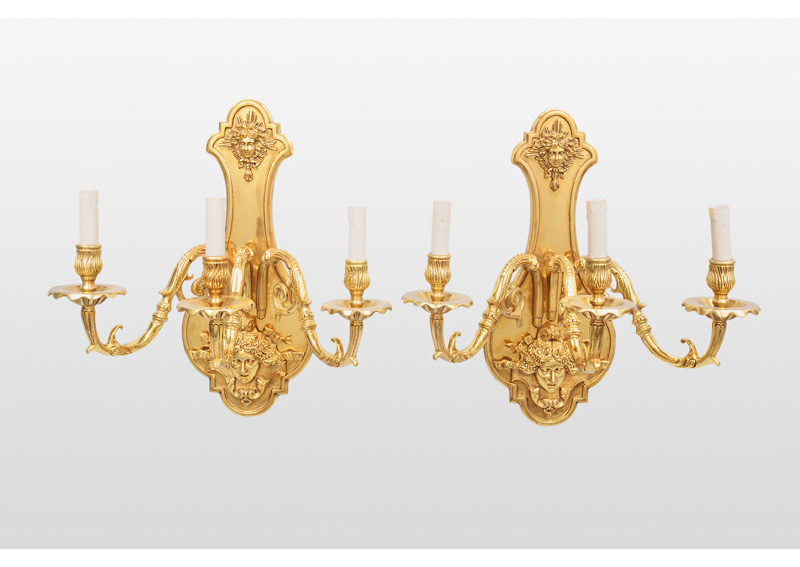 A pair of wall lights in Louis XIV style