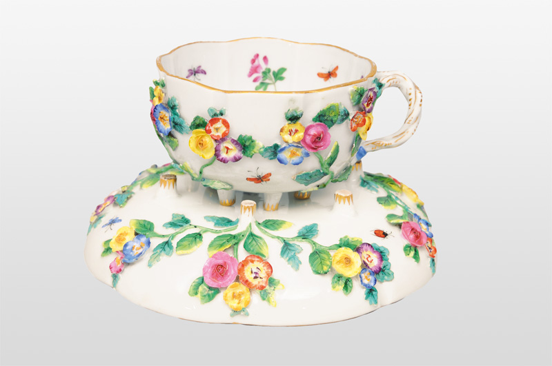 A cup with plastical decoration