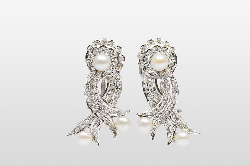 A pair of diamond pearl earrings