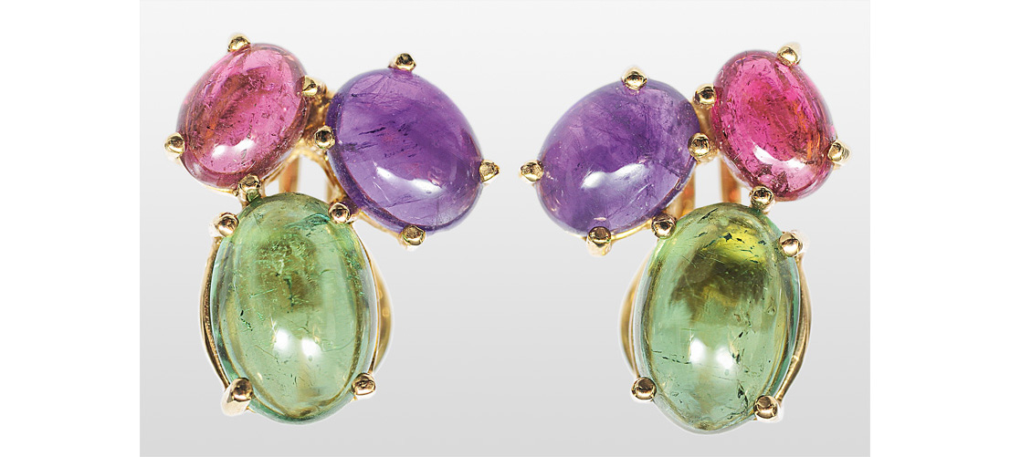 A pair of earrings with colour stones