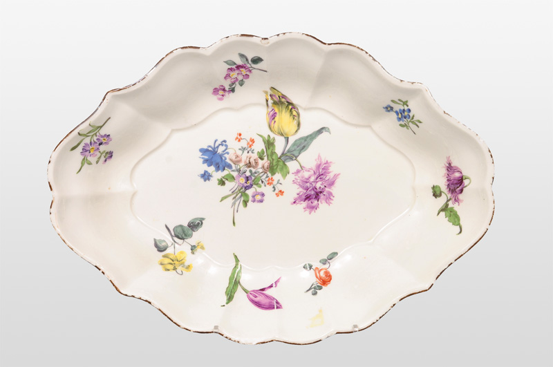 An oval bowl with flower painting
