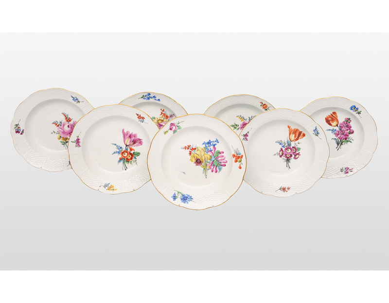 A set of 5 soup plates with flower painting