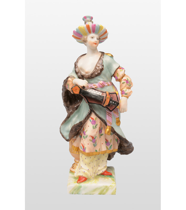 "A figurine ""Chinese woman with hand organ"""