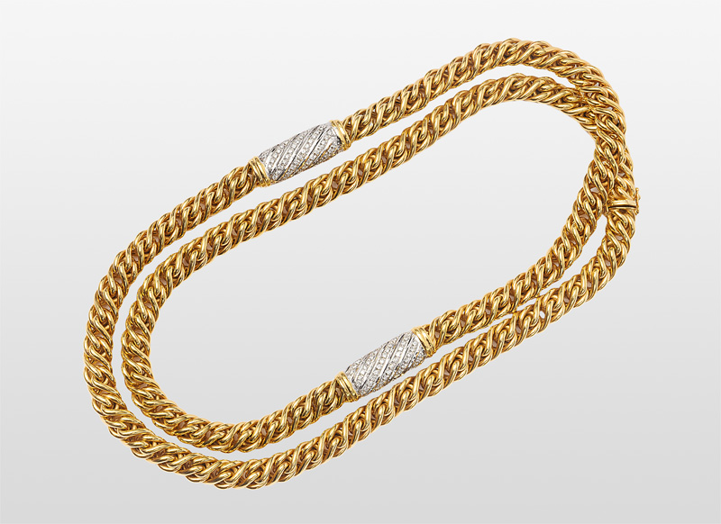 A long golden necklace with diamonds
