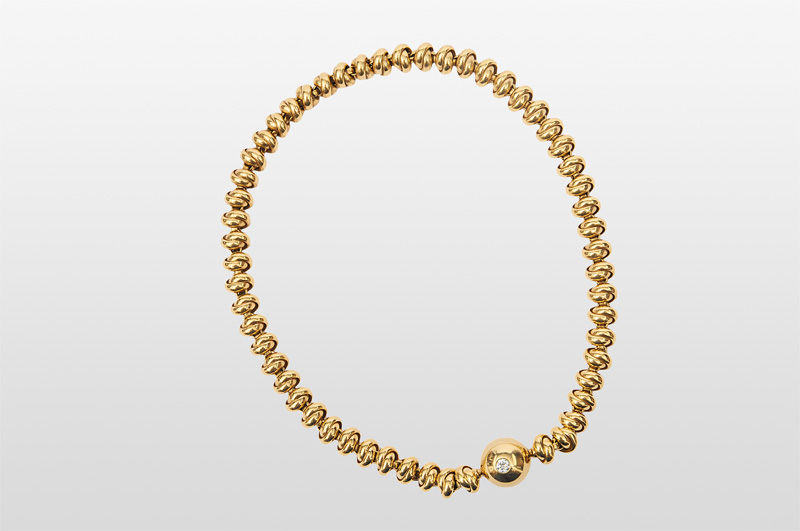 A golden necklace with diamond-clasp