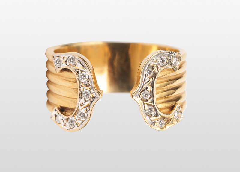 A golden ring with diamonds