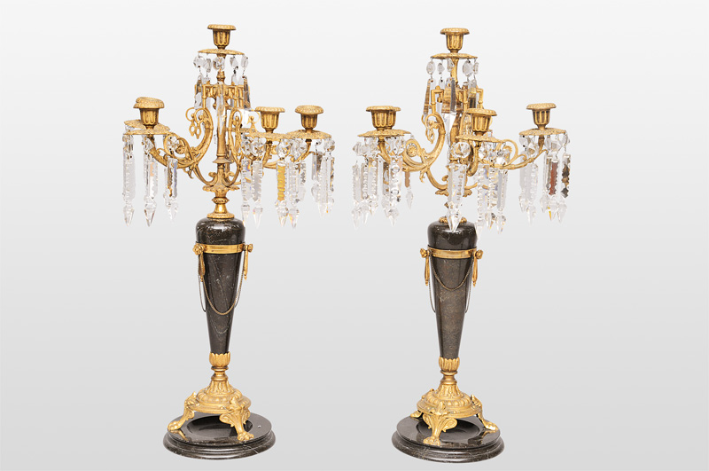 A pair of large candle holders with cristall glass
