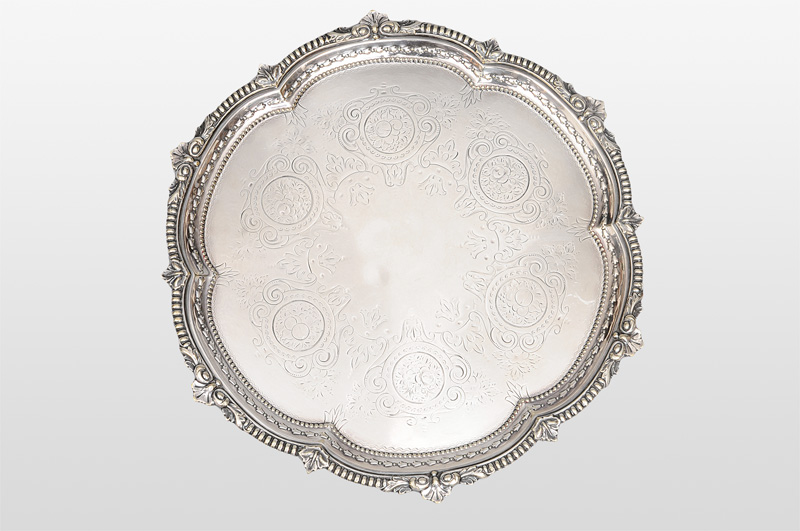 A salver with reliefed rim