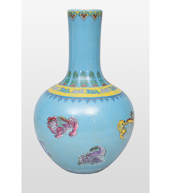 A bottle neck vase with mythical creatures