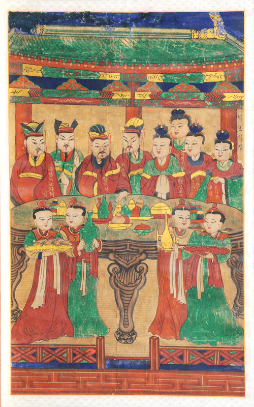 A framed scroll painting of an ancestor group