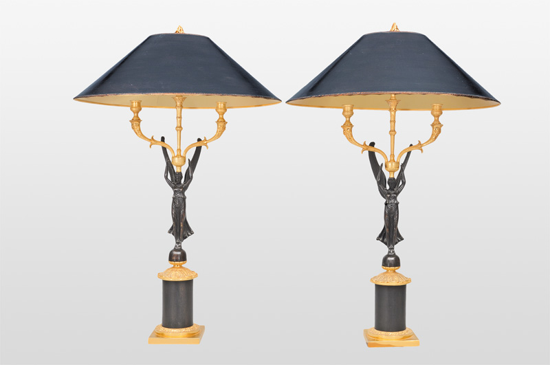 A pair of girandole lamps with Victoria figures in the style of Empier