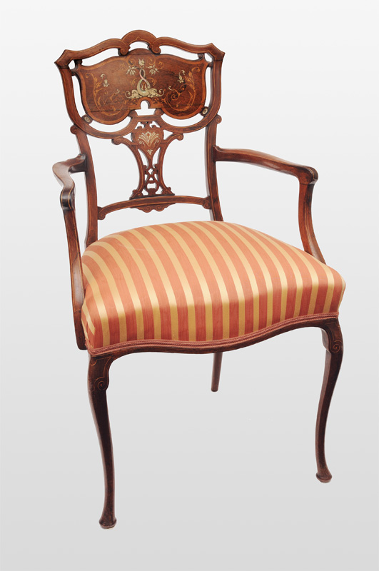 An armchaire with ivory and nacre marquetery