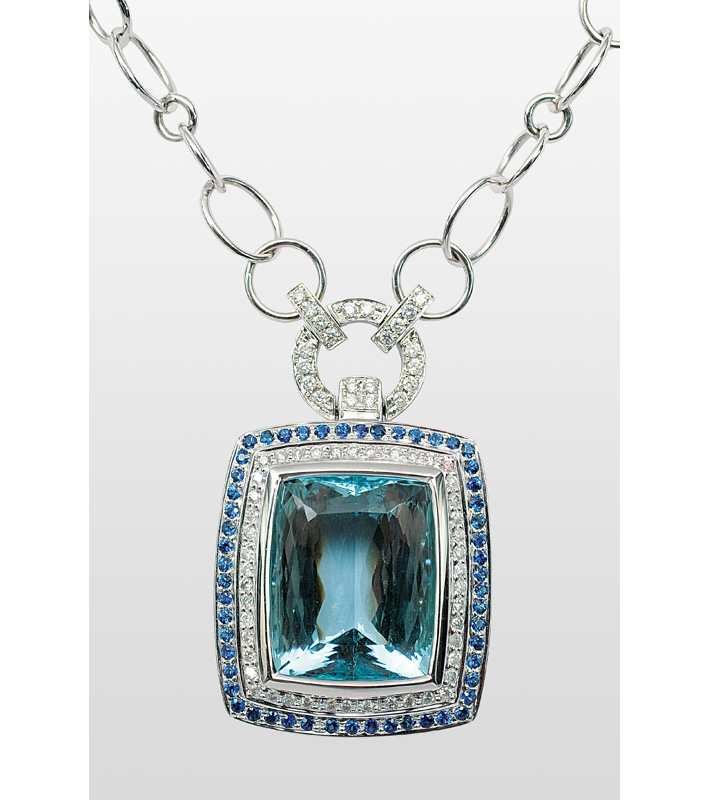 A large aquamarin diamond sapphire pendant with necklace