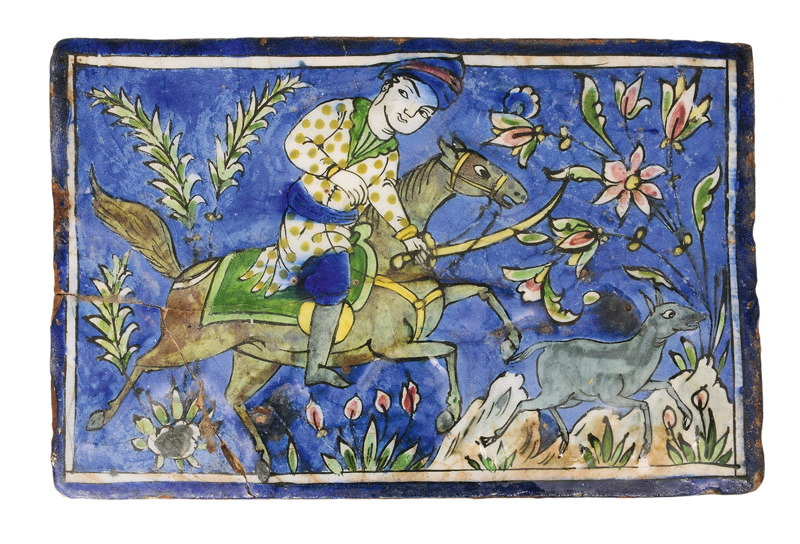 A large Qajar tile with hunting scene