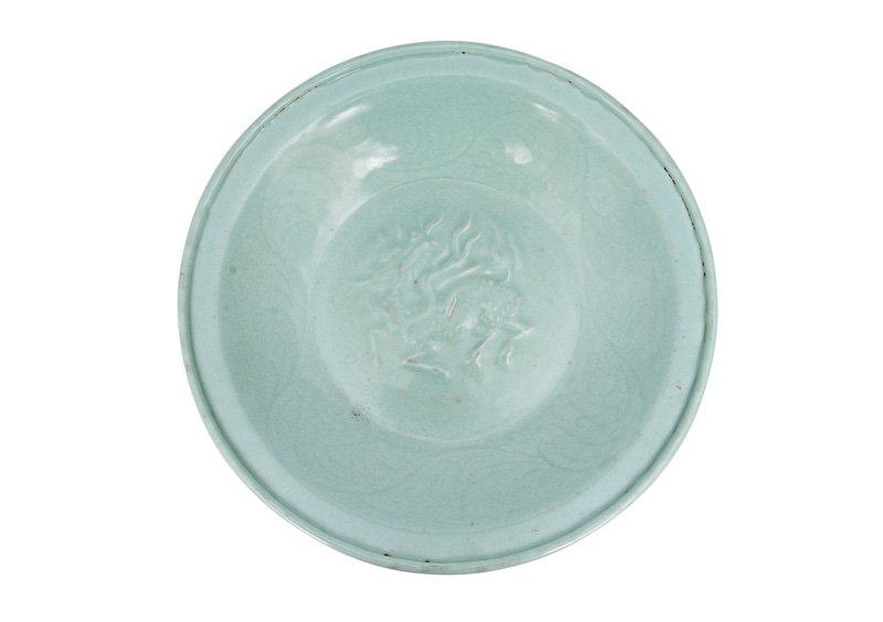 A large moulded celadon plate with Qilin-creature