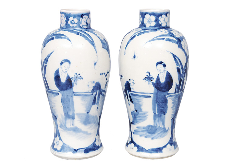 A pair of baluster vases with garden scenes