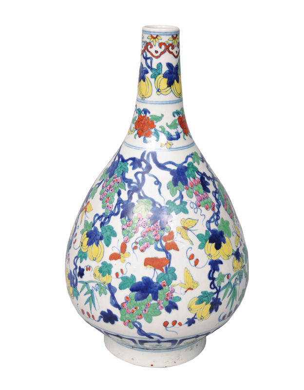 An exceptional Doucai bottle vase with grapes and butterflies