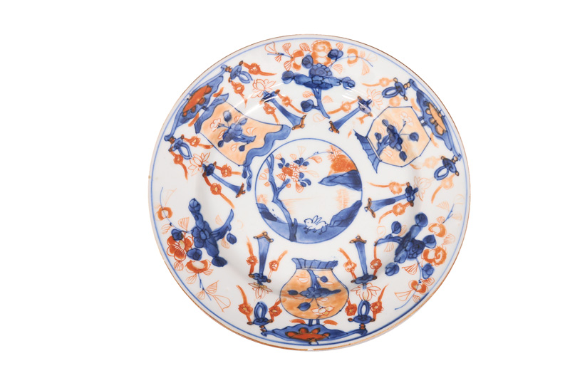 An Imari plate with lanters and hare