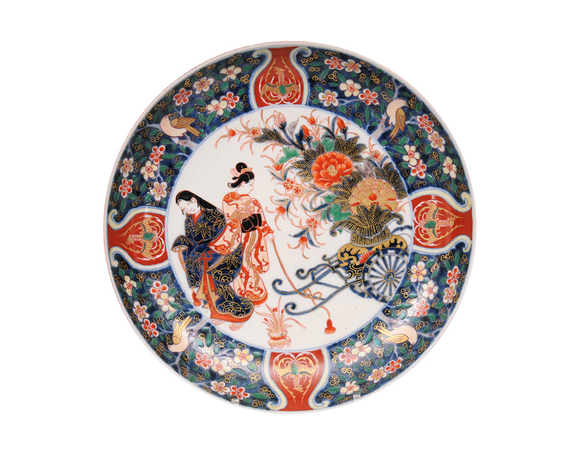 A large Imari plate with ladies