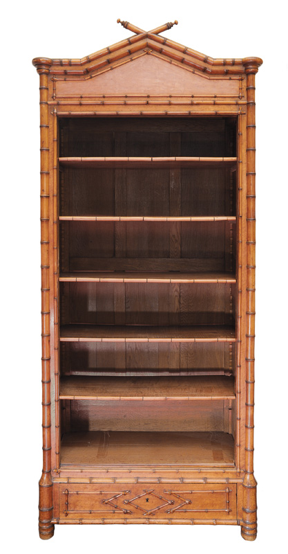 A bookshelf with bamboo decoration