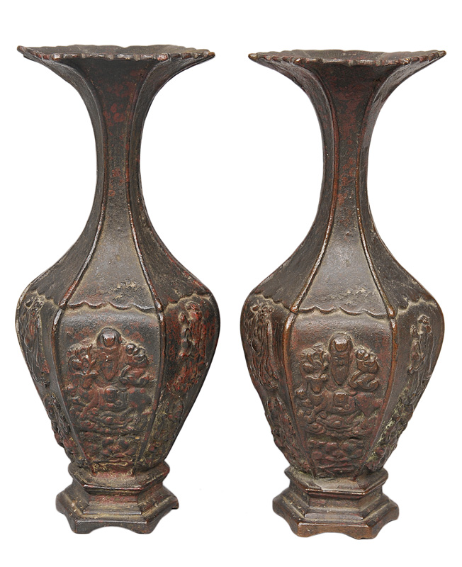 A pair of small hexagonal bronze vases with Taoist deities