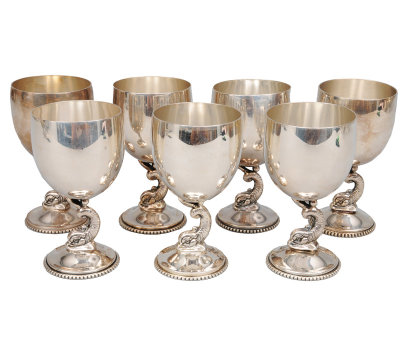 A set of seven foot cups with delphin