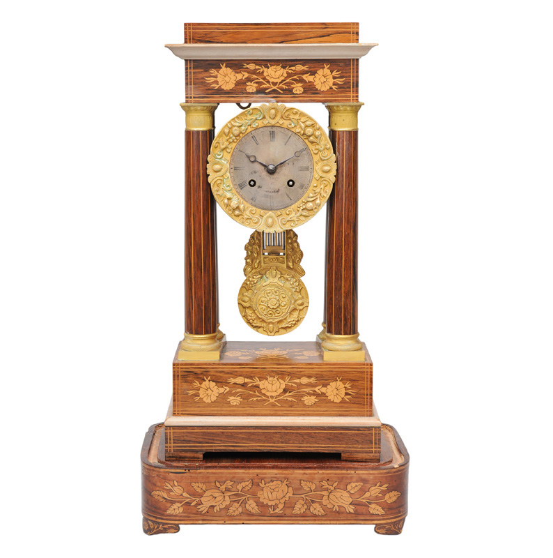 A mantle clock with floral marquetry