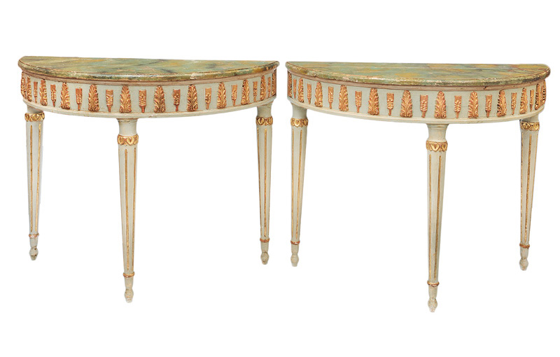 A pair of coloured demi lune console tables