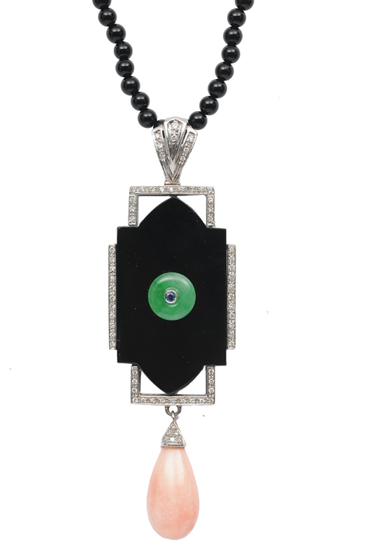 An onyx necklace with pendant in onyx, coral and jade in the style of Art-déco