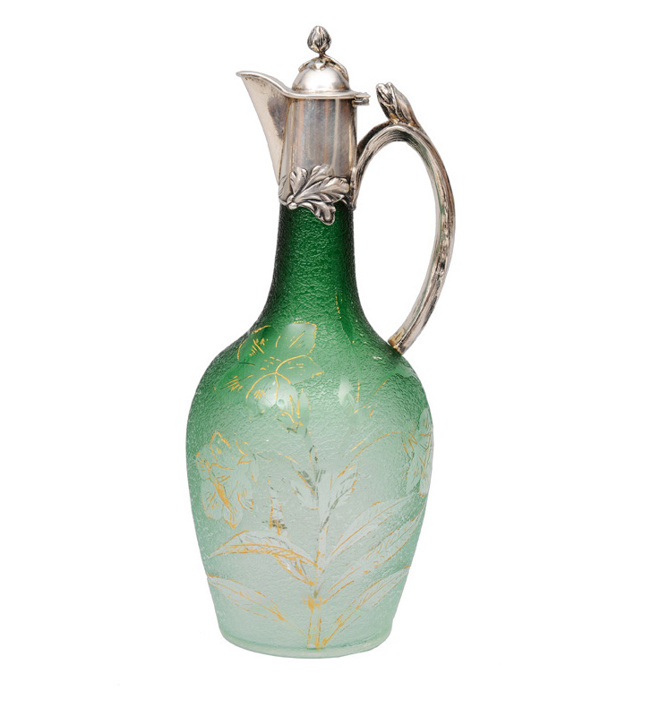 An Art Nouveau glass jug with silver mounting